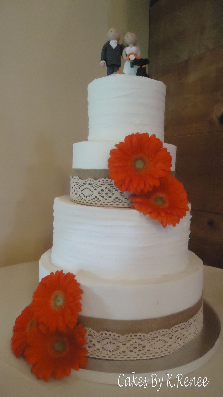 Burlap, lace and gerbera daisy wedding cake.
