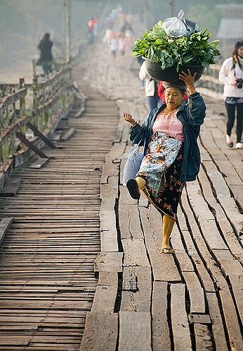 Mon woman dancing on the bridge . Sangkhlaburi, Thailand
