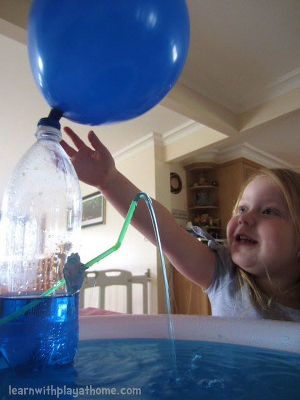Water bottle fountain. What is better the kids learn with play? Kids enjoy great fun when the air from the balloon pushes the water out through the straw! And this is also a science lesson. Materials you need for this game: empty water bottle, balloon, straw, blu tac (or similar), tray for catching the water (optional).
