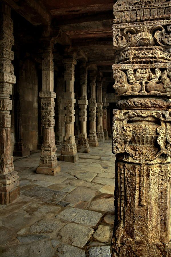Finely carved columns at Quwwat ul Islam Mosque in Qutub Minar Complex, Delhi, World Heritage Site