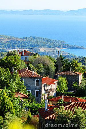 Traditional village with northern Greek architecture in Partenonas, Chalkidiki, Greece. The resort of Porto Carras can be seen in the background.