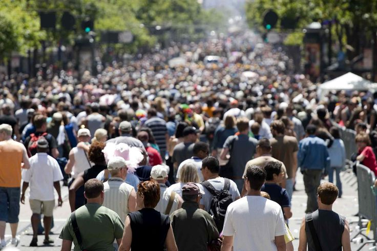 A large crowd of people walking