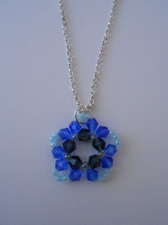 Flower / star necklace with blue light blue di BlueBupCreations, €4.50