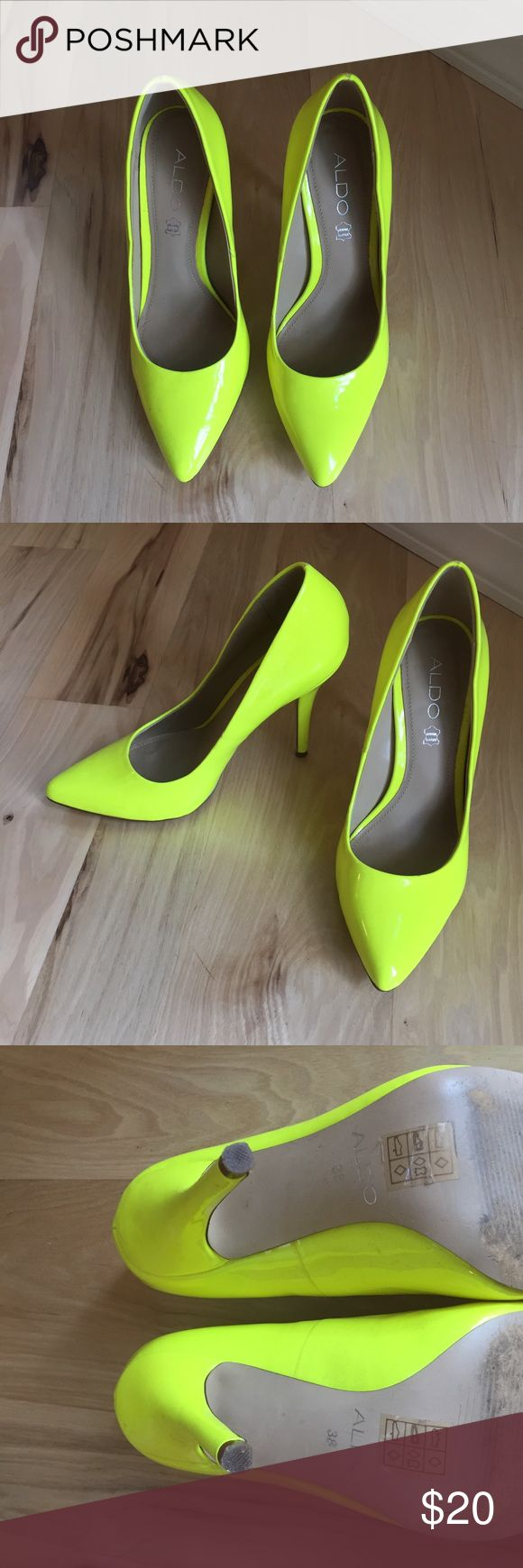 Aldo Pumps Neon yellow pumps that I wore as a bridesmaid and only one or two other occasions. Slightly scratched on the left heel. Size 38 but fit like a 7.5. Aldo Shoes Heels