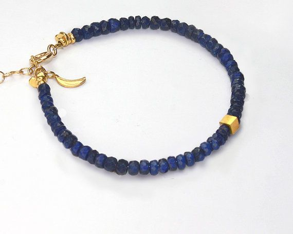 Hey, I found this really awesome Etsy listing at http://www.etsy.com/listing/115028879/tweedle-2-gold-and-sapphire-bracelet-or