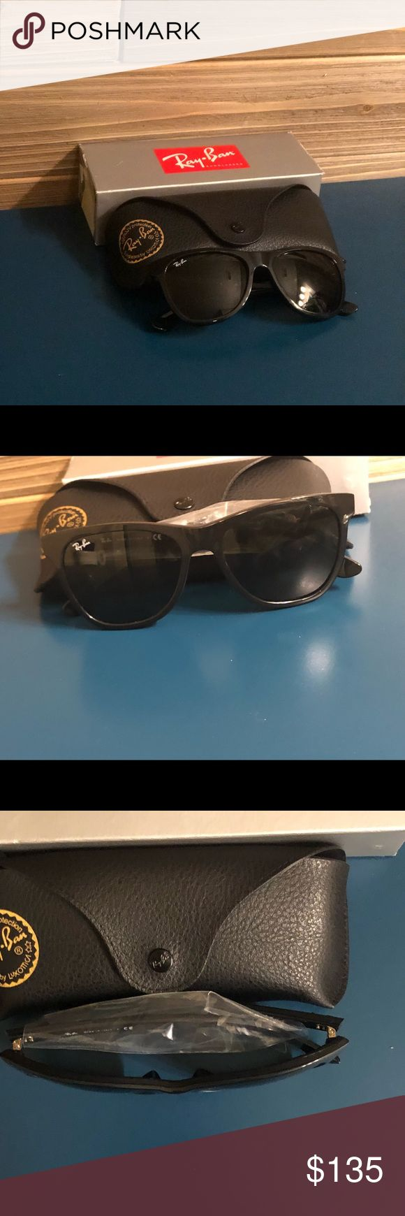 NEW IN BOX-Ray Ban Wayfarers 🕶 Still in packaging. Only opened to take picture.  The opening to the box was ripped (pictured) but still in tact and will be included with purchase.  These are black-Stylish Wayfarer Ray Ban. Truly a must have accessory.  Interested? Make me an offer or place in bundle. 🕶🕶 PER THE MANUFACTURER ➡️ Lenses absorb up to 80% of visible light and 100% of all UV and some blue light, providing true color perception. Measurements: Eye Size: 52 2⁄5 mm Bridge: 22 1⁄2…