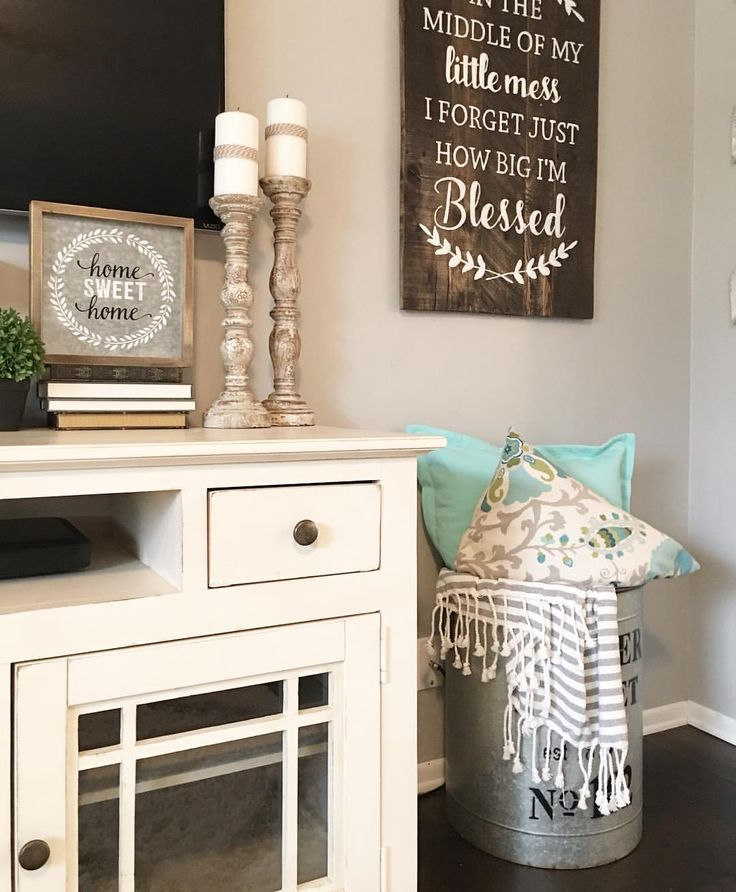Living Room Decor, farmhouse decor, farmhouse Style, neutral decor, candlesticks, hobby Lobby decor, throw pillows, throw blanket, white tv stand, See Instagram photos and videos from Robin Norton (@rock.n.robs)
