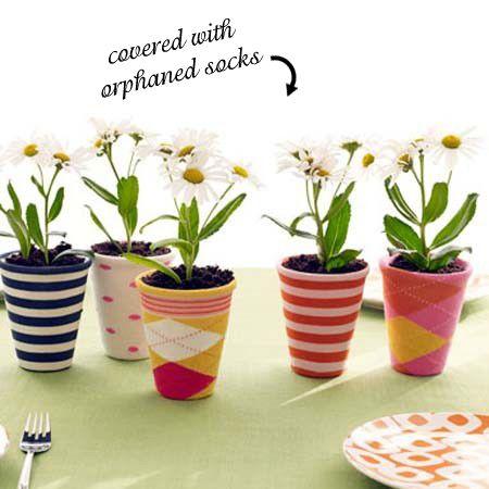 cute idea. repurpose old socks and create cute and unique planters