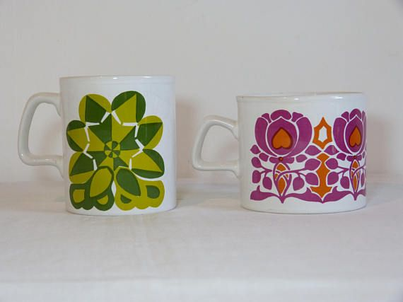 Set of 2 funky mod flower STAFFORDSHIRE ceramic coffee mugs - French 60s 70s vintage 2 different funky mod flower patterns on a white background made of glazed ceramics, made in England by Staffordshire Potteries the geometric green floral decor mug: multiple crazing inside & outside the mug, a few light traces of use on the floral decor the purple & orange Art Nouveau inspired floral decor mug: multiple crazing inside the mug, some chips on the edge fair condition  the green mug: hei...