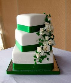Pretty three offset tiers with green ribbon edging and cascading roses. ᘡղbᘠ