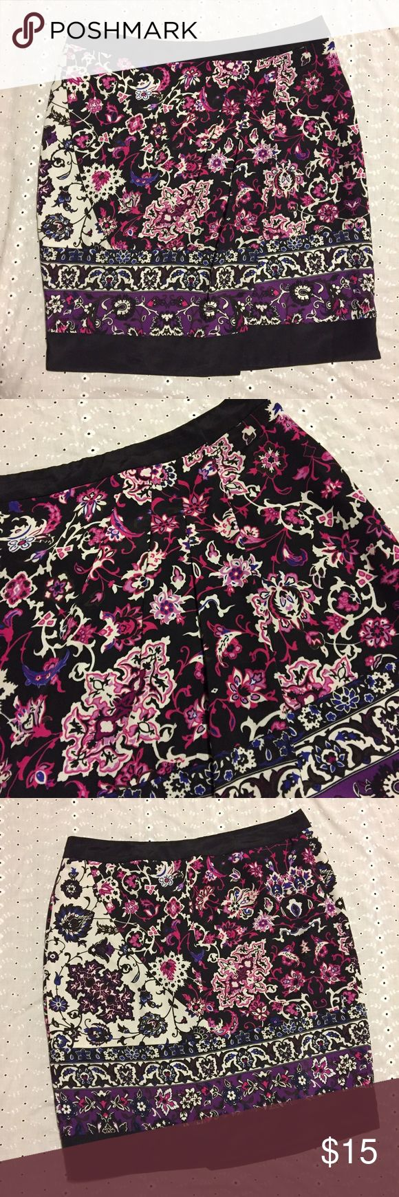 """New York and Company Floral Wrap Skirt! Beautiful floral wrap skirt from New York and Company! Has pleats along the top which make the skirt lie beautifully! Colors include black, white, purple, navy, magenta, and white! Would make a great addition to a career wardrobe! Size 10! Waist is 16.5"""" lying flat, length is 23""""! Perfect condition! New York & Company Skirts Pencil"""