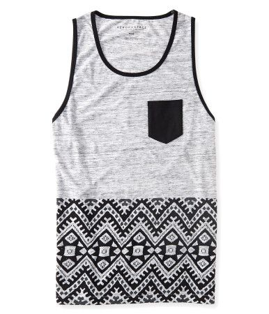 """Live your life wild 'n' free in our Aztec Block Print Pocket Tank! The light heathered material is accented with a bold geo pattern along the hem, while a solid chest pocket adds cool contrast. Slip it on with a pair of denim shorts before setting out on your next adventure!<br><br>Authentic fit. Approx. length (M): 28""""<br>Style: 6132. Imported.<br><br>60% cotton, 40% polyester.<br>Machine wash/dry."""