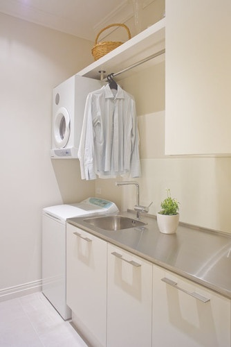 Laundry Rm. - Consider rail (shower rod) above washer/dryer for hanging....