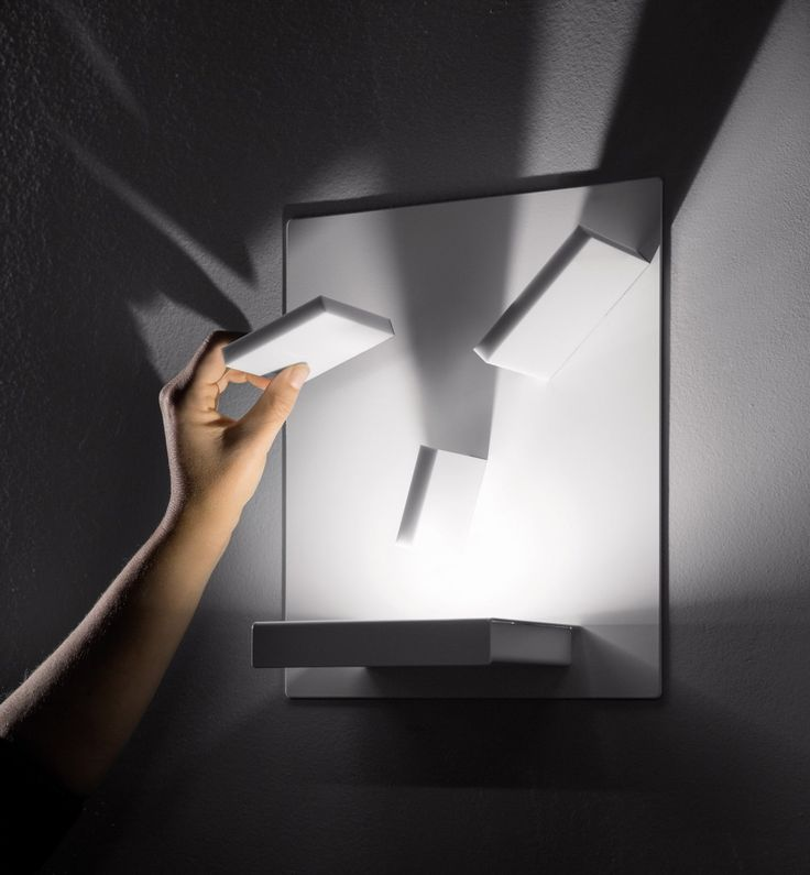 Domino by Studio Italia Design is on of the products with the highest possibility of individualization. The lamp has a metal plate which can be fit three magnetic modules. The individual by costumer designed lighting scenario, changes depending on the orientation and position of the pads.