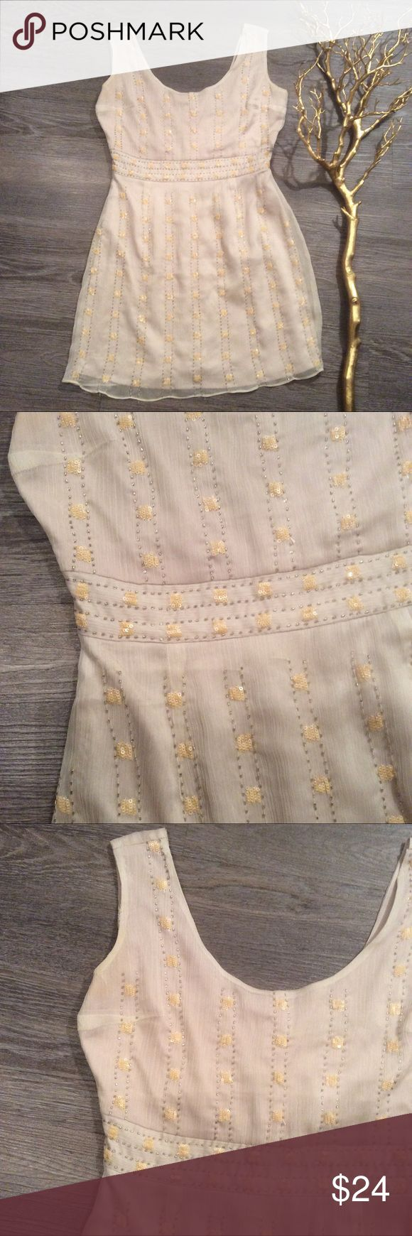 "🌻Beautiful sequin Dot stripe mini Dress dainty S Pretty whimsical little number in a beige tone and pastel yellow and white sequined dots in vertical, stripes. In great condition! This is short approx. 32"" so marking this as a petite. Modcloth Dresses Mini"