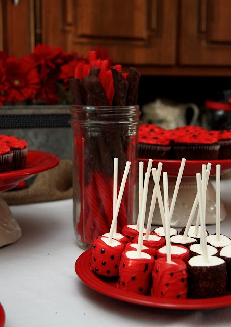 Ladybug Marshmallows.  The source includes lots of decorating ideas for a ladybug theme.