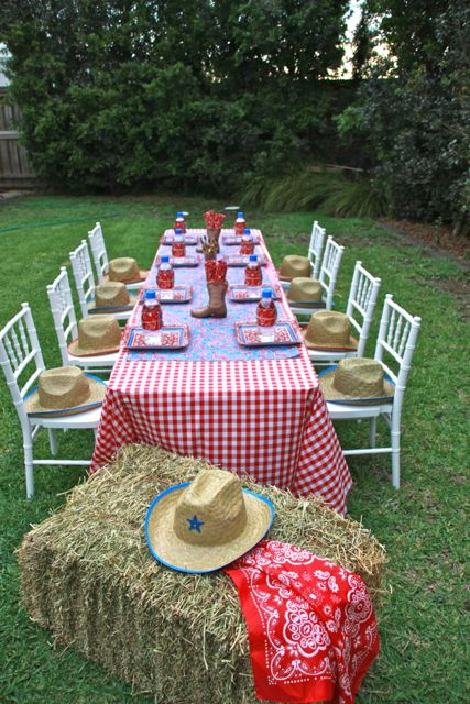 Table for a Cowboy Party (love the hats on the chairs!)  #cowboy #party