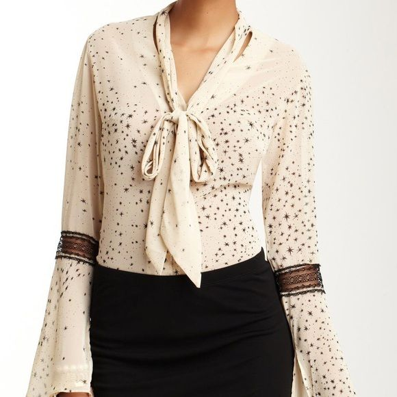 """Beige Long Bell Sleeve Star Blouse Romantic details give this button down a feminine flair. Show off your girly style while working at the office.   V-neckline Long bell sleeves Tie front Button front closure Lace trim Approx. 26"""" Length  No Trades Boutique Brand  Tops Blouses"""