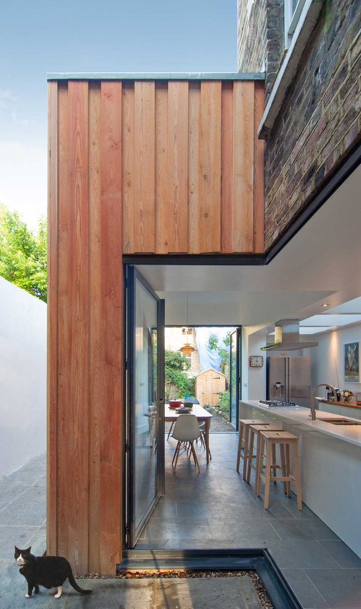 New timber box connects to existing brick work. Yoakley Road by Bradley Van Der Straeten Architects.