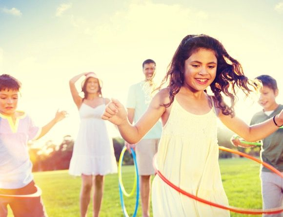 Our family hula hooping activity is perfect for a fun-filled family BBQ or weekend workout!