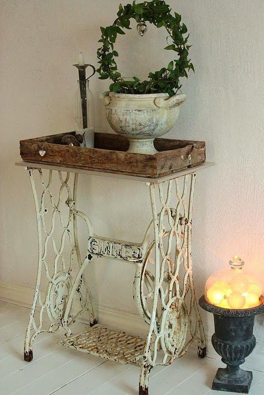 Table made out of an old cast iron sewing machine base and a work bench top by Matthew Ellio