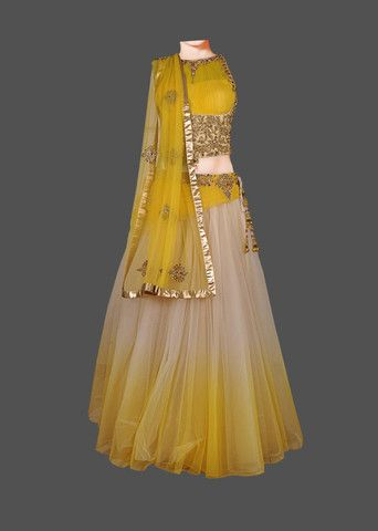 Featuring a yellow & gold shaded net lehenga, with swarovksi, cut-dana, and stone hand embroidery. The skirt is finished with silk, cancan, and satin underneath. This lehenga is paired with a yellow c