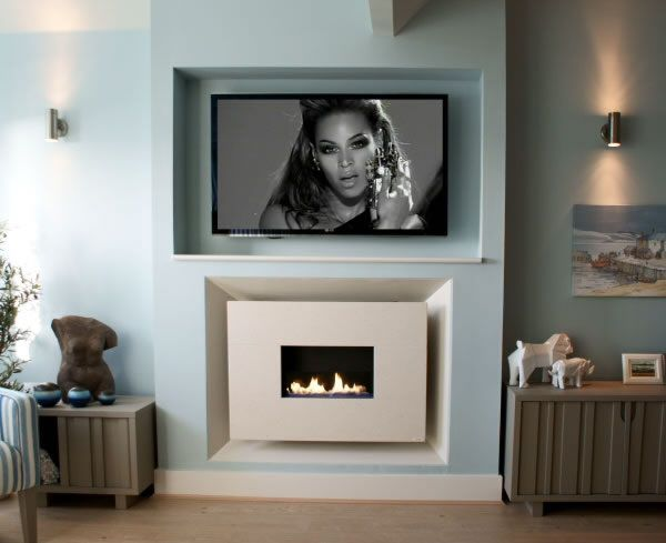 Recessed Flueless Gas Fire - Classico Widescreen Limestone with TV above by Ben Huckerby Design