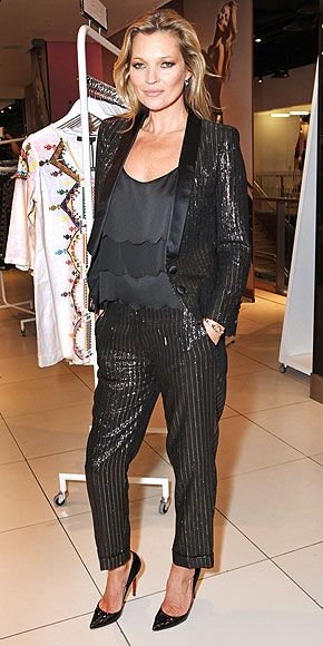 """Kate Moss in shimmery striped tuxedo jacket & cropped pants with Christian Louboutin """"So Kate"""" stilettos at the launch of her latest collection for Topshop in London"""