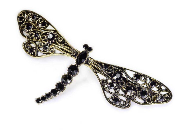 Spinka z francuskim automatem o długości 8 cm, wykonana w kształcie złotej ważki wysadzanej czarnymi kryształowymi kamieniami. Prawdziwy szyk i elegancja.