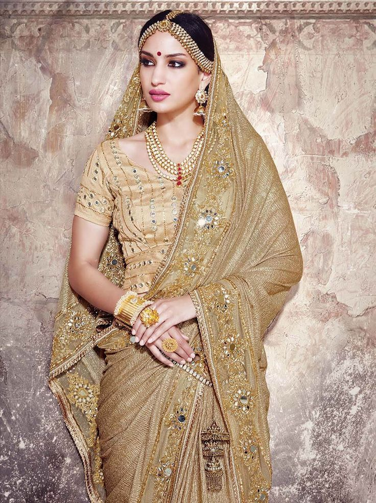Fancy fabric designer saree in rich Golden color with beautifully crafted work and gota blouse