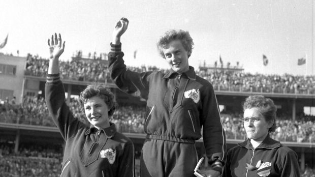 Marlene Mathews, left, Betty Cuthbert and Christa Stubnick on the podium at the 1956 Olympic Games in Melbourne.