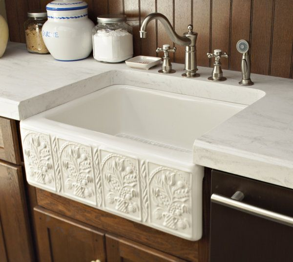 Farm sink surrounded by rain cloud corian countertop for Corian farm sink price
