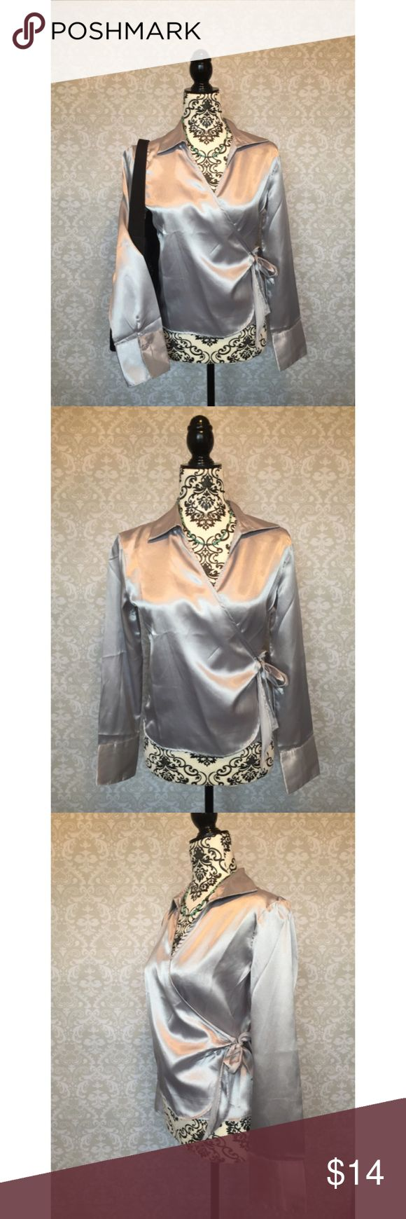 Satiny silver GAP wrap top Elegant silver satiny GAP wrap top. Perfect over a cami. Size is flexible: the side tie allows for adjustment. Versatile. No signs of wear noted.  🌟 I have an identical plum top listed. Bundle and save! GAP Tops Blouses