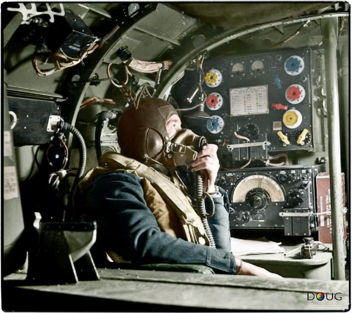 C: Flying Officer R. W. Stewart, a wireless operator on board an Avro Lancaster B Mark I of No. 57 Squadron RAF based at Scampton, Lincolnshire, speaking to the pilot from his position in front of the Marconi TR 1154/55 transmitter/receiver set. c.1942-43