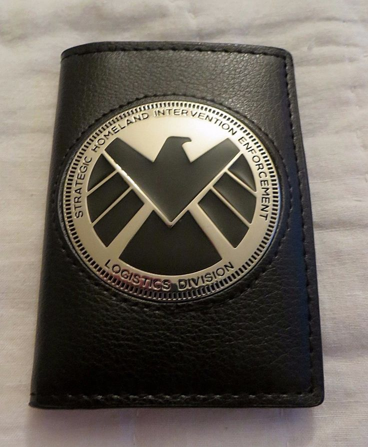 Up for sale is the badge wallet pictured. What is a badge wallet? Also called an ID wallet, this is not your typical bi-fold wallet. There is no long slot for dollar bills. There's 2 slots that will h
