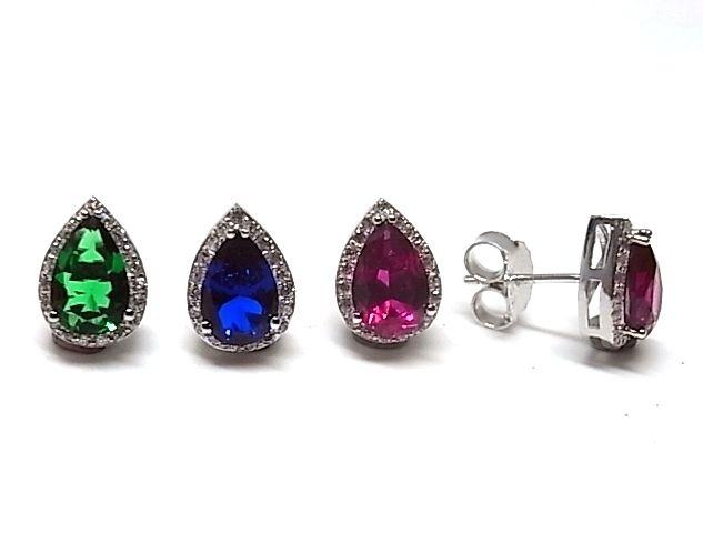 Pendientes de plata de primera ley con circonitas y una grande en el centro con forma de gota, con cierre a presion y color a elegir verde, rosa o azul. REF.:110228890123. PRECIO: 29,80 €