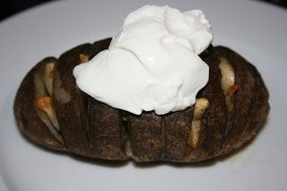 CrockPot Garlic Baked Potatoes -                                       -4 big brown potatoes --2 tablespoons melted butter --2 tablespoons olive oil --salt and pepper --8 or so garlic cloves