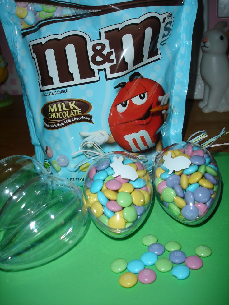 Fill Plastic Eggs with Pastel M&MS and add a Bunny cut from Cricut. Tie the top with co-ordinating Raffia