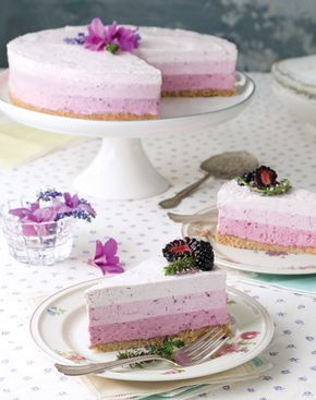 Truly a showstopper, frozen Ombré Berry-and-Yogurt Torte features silken layers of blackberry filling atop a crisp caramelized-biscuit crust.