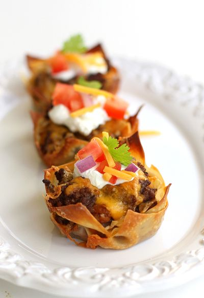 "Taco Cupcakes Recipe ~ wonton wrappers are used as your ready-to-go ""pasta"" and are layered in a cupcake tin with all of the fabulous fillings you'd find in a taco. The wonton wrappers bake up quickly and have the perfect chewy\crispy texture."