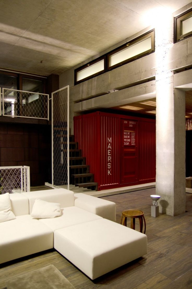 Red Maersk Shipping Container in Industrial Loft Apartment by 2B Group