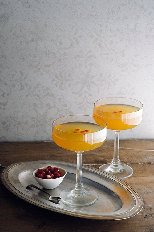 Long Kiss Goodnight -  Bourbon, Grand Marnier, Blood Orange/Mandarin/Clementine Juice, Sparkling Wine, Pomegranate Seeds for Garnish.