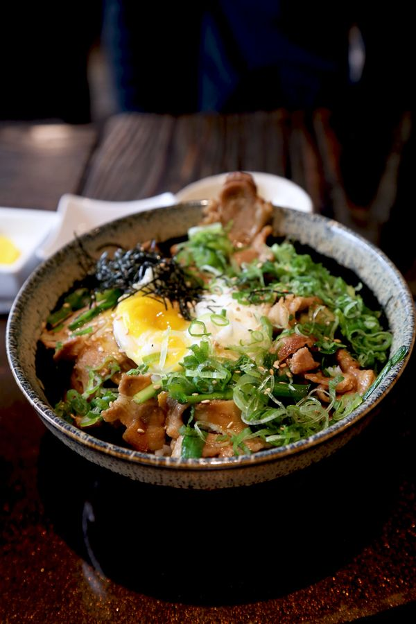 Pork Stamina-Don - thinly sliced pork with garlic and scallions, simmered in a soy mirin sauce and topped with a poached egg.