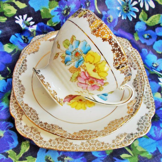Beautiful china trio by Phillips for Lawleys of Regent Street. Made in the 1930s Pattern number 9694 Trio consists of teacup, saucer and tea plate White background with a lovely design of briar roses in yellow, pink and blue. The leaves are soft green and pale brown. The cup