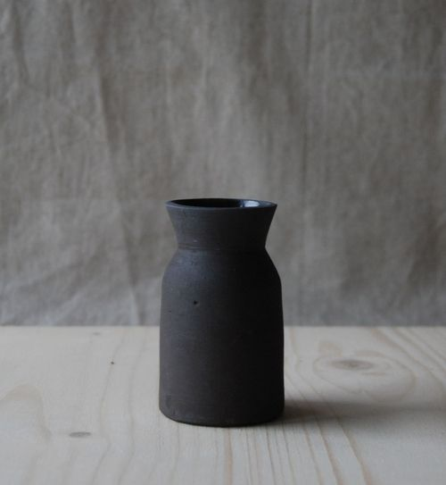 Small carafe handmade by potter Jono Smart, in black matte clay with black gloss interior. A ceramics collector's dream.