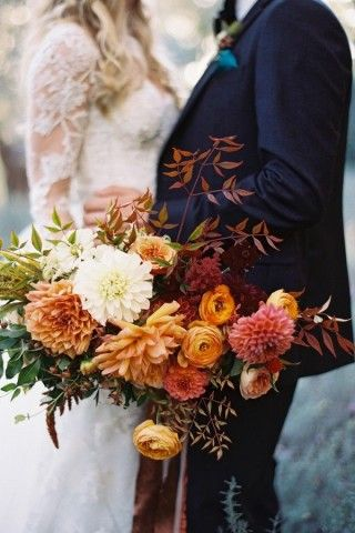 Be inspired to plan an autumn wedding with a sweet fall wedding color palette, featuring orange, burgundy, peach, and a navy blue foundation.
