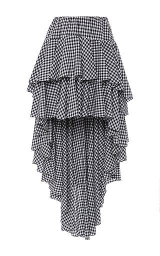 This **Caroline Constas** Giulia Asymmetric Gingham Skirt features a high rise waist, tiered ruffled silhouette, and an asymmetric hem.