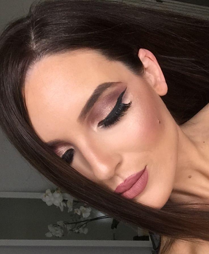 Full glam makeup modern makeup winged liner plum eyeshadow brows