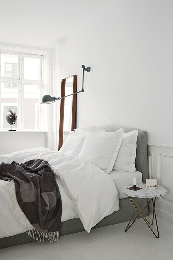 Sleek bedroom design in white and grey