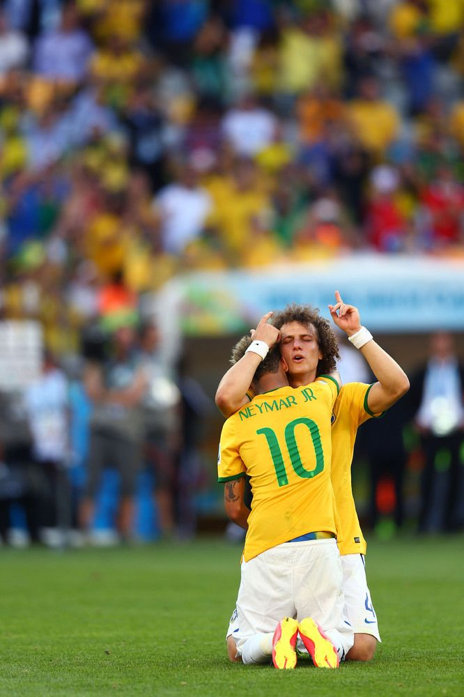 BELO HORIZONTE, BRAZIL - JUNE 28: David Luiz and Neymar of Brazil celebrate after defeating Chile in a penalty shootout during the 2014 FIFA World Cup Brazil round of 16 match between Brazil and Chile at Estadio Mineirao on June 28, 2014 in Belo Horizonte, Brazil. (Photo by Ronald Martinez/Getty Images)